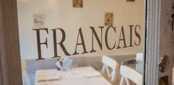 Francais word in a glass door of a restaurant