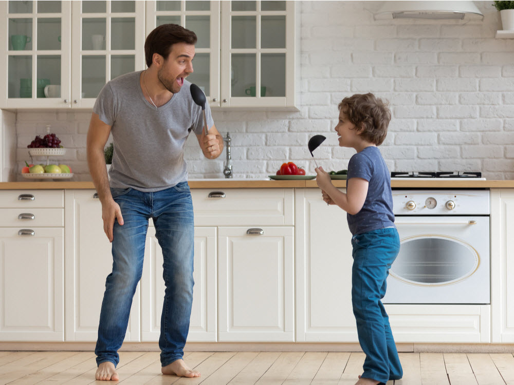 Father and son having fun at the kitchen